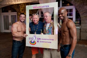 Guests pose with male models at the Barefoot Bear Garten